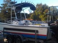 - Mako 23' Middle console-200 H.P. Mercury Blackmax and