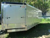 2011 8.5x26ft V nose Cargomate snowmobile trailer. This