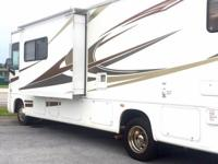 This class a motor home has 75,591 miles, set of bunks