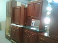 A dark wooden cabinet set. Comes with golden handles