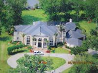 MAGNIFICENT PRIVATE LAKE LOT RESIDENCE! SHOWPLACE IN