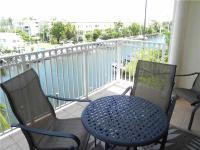 BEAUTIFUL 2 STORY CONDO WITH DEEPWATER ASSIGNED DOCK