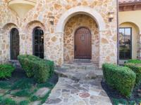 Executive Mediterranean home with exceptional custom