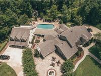 Exquisite custom home on very private 16 acres
