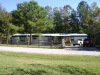 This 3 acre home includes two mobile houses equally 3