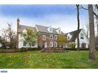 Spectacular, pristine, center hall colonial on a