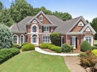 Beautiful four-sides brick home with three car garage.