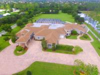 This exquisite estate is situated on 5 acres in the