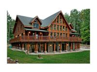 Spectacular log home sitting on 22 wooded acres with