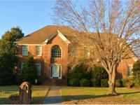 Stunning custom all brick transitional with exceptional
