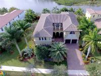 Magnificent Heron Bay Estate Home Located On A Premium