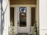 Professional landscaping and a beautiful entry give