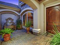 Within the guard-gated community of Royal Oaks Country