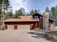 Beautifully updated custom built home on 5.4 treed