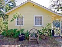 Lovely cottage on a sunny 1/2 acre lot in the stunning
