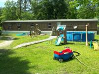 12 + acres with 3 bedroom 2 bath single. Has a big
