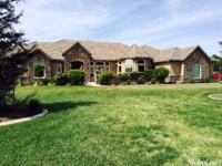 This fabulous home on 4+ irrigated acres currently