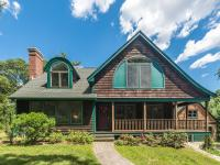 This charming shingled cottage is sited on 7+ lush