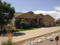 This beautiful Walkout Ranch is a custom home with a