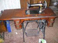This is an old treadle (non electrical) Singer in great