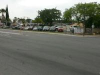 USED CAR LOT IN BUSY CEDAR AVENUE IN THE CITY OF