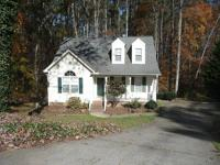 Adorable cape cod in desirable location with a Washer &
