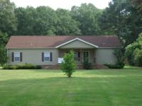 This home sits on 2 beautiful acres! It has landscaping