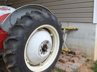 2 tractor tires mounted on new wheels they have no wear