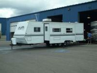 2002 328 Layton Scout travel trailer, sleeps 9, queen
