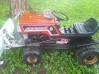 this is a mid 80s 11hp briggs dynamark lawn tractor