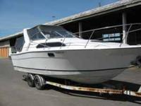 BAYLINER CONTESSA WITH TRAILER HAS A 265HP MERCRUISER
