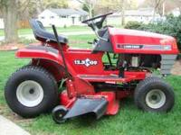 12.5 Horsepower riding lawn mower. Excellent condition,