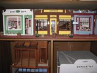 Selling collection of dollhouses and miniatures.