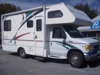 1999 Gulf Stream Conquest 23' Class C. It has a Ford