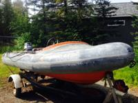 An older 12' Avon rigid hull inflatable with 30hp