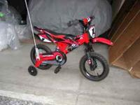 Looks like a red dirt bike, excellent condition, bought