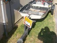 12 ft fiberglass boat and trailer for sale, $500 OBO.