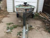 12 foot aluminum boat with 6 hp Johnson engine. Also