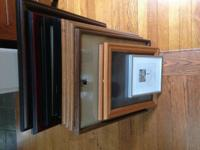 We're selling a dozen beautiful large picture frames.