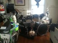 For sale a black 12 piece drum set with all hardware