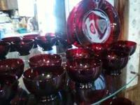 I have a 12 place setting of ruby red dishes. All are