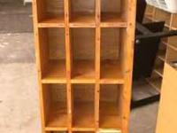 12 Slot Wooden Shelf Rack. In great condition made of