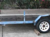 This is a 12' x 6' flat deck trailer, with single axle.