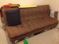 This is a nice modern metal frame futon. I believe it