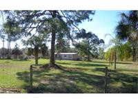 A great house on 2.94+/- fenced acres, with