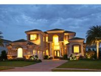 SPECTACULAR CUSTOM ESTATE with a WATER VIEW in front,