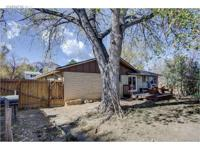 Table Mesa ranch home on large corner lot! Features