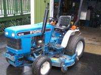 1215 ford tractor 4x4 with 5ft mower and 3 pt. hitch