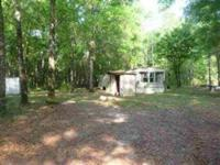 This listing is for the purchase of both this 6.20 acre