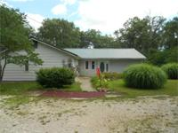 1.5 a/c. m/l with a good little cattle ranch house with